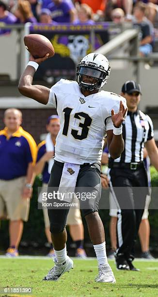 Knights quarterback Justin Holman throws a pass in a game between the East Carolina Pirates and the Central Florida Knights at Dowdy-Ficklen Stadium...
