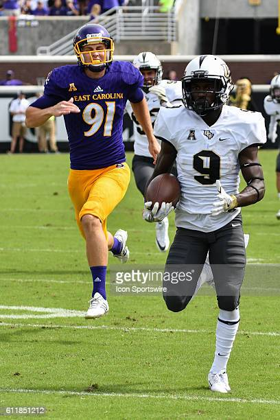 UCF Knights running back Adrian Killins returns a kickoff back for a touchdown in a game between the East Carolina Pirates and the Central Florida...