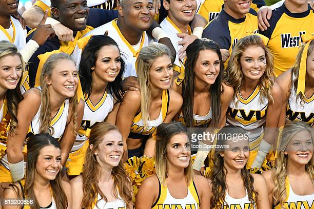 West Virginia Mountaineers cheerleaders pose during a NCAA football game between the Kansas State Wildcats and the West Virginia Mountaineers at...