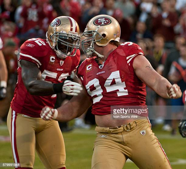 San Francisco 49ers linebacker Patrick Willis helps defensive tackle Justin Smith celebrate sack on Sunday October 10 2010 at Candlestick Park in San...
