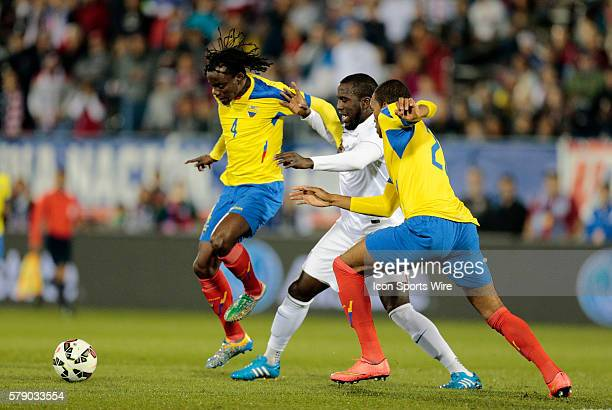 Ecuador's Juan Carlos Paredes and Luis Canga sandwich United States' Jozy Altidore The Men's National Team of the United States and the Men's...