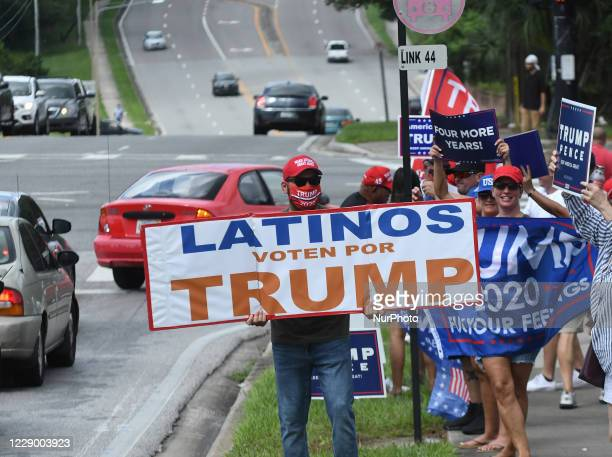 October 10, 2020 - Orlando, Florida, United States - People hold placards after U.S. Vice President Mike Pence addressed supporters at a Latinos for...