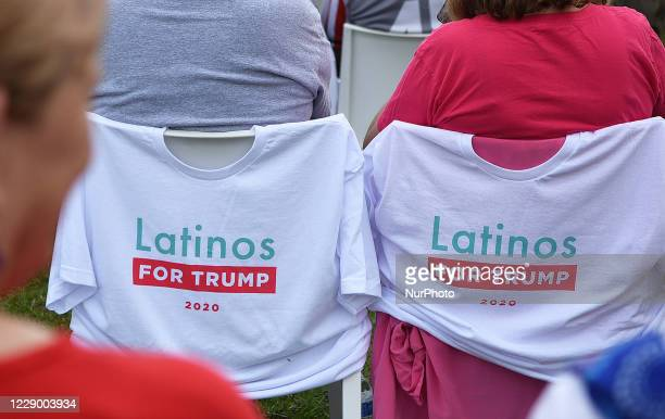 October 10, 2020 - Orlando, Florida, United States - T-shirts placed on chairs by people waiting for U.S. Vice President Mike Pence to arrive to...