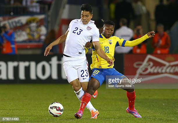Bobby Wood of the USA MNT is tackled by Jonathan Gonzalez of Ecuador during an international friendly match at Rentschler Field in East Hartford CT...