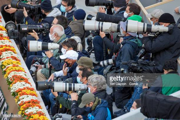 October 10. Photographers in position to photograph the trophy presentation to winner Iga Swiatek of Poland after her victory against Sofia Kenin of...