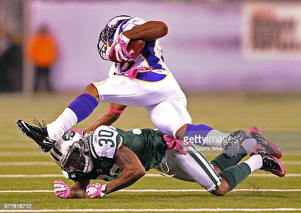 Minnesota Vikings at New York Jets at New Meadowlands Stadium in East Rutherford NJ Minnesota Vikings' RB Adrian Peterson runs over New York Jets' CB...