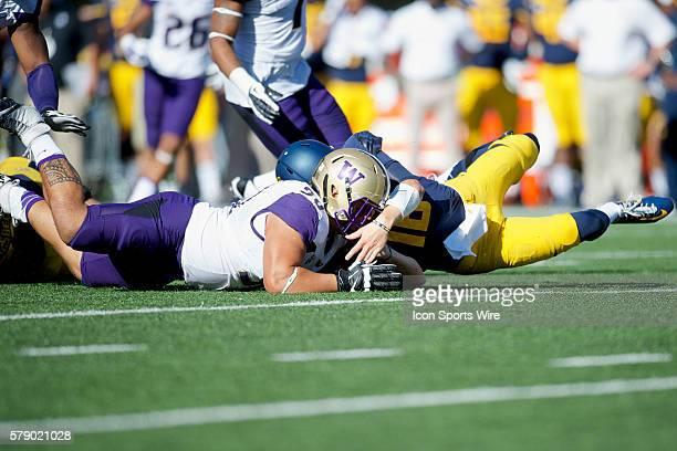 Washington defensive lineman Taniela Tupou recovers a fumble by California quarterback Jared Goff during the NCAA football game between the...