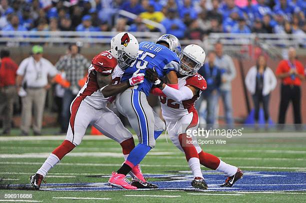 Detroit Lions wide receiver Golden Tate makes a short gain as Arizona Cardinals cornerback Jerraud Powers and Arizona Cardinals free safety Tyrann...