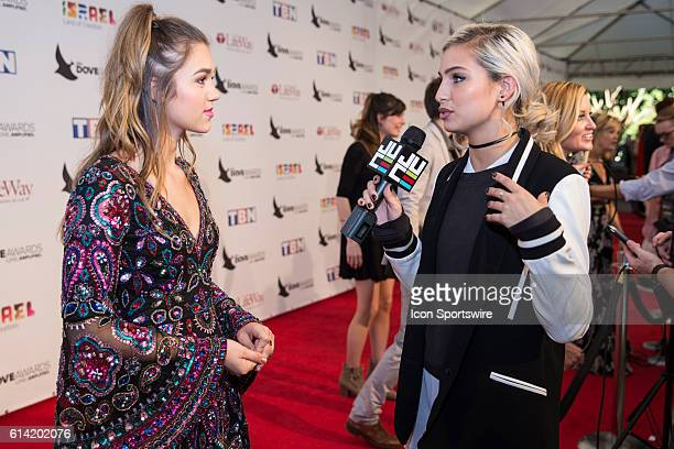 Sadie Robertson conducts an interview with JUCE TV at the Red Carpet at the 47th Annual Gospel Music Association Dove Awards at Allen Arena in...