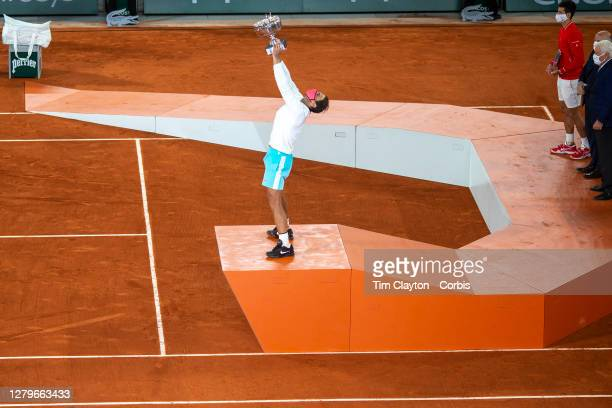 October 11. Rafael Nadal of Spain raises the trophy aloft after his victory against Novak Djokovic of Serbia in the Singles Final on Court...