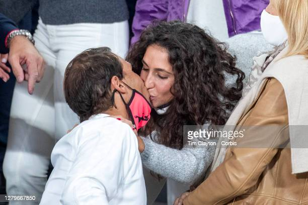 October 11. Rafael Nadal of Spain receives a congratulatory kiss from his wife Xisca Perello after his victory against Novak Djokovic of Serbia in...