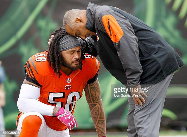 Cincinnati Bengals head coach Marvin Lewis stops to encourage line backer Rey Malauga prior to their 3737 tie against the Carolina Panthers during at...