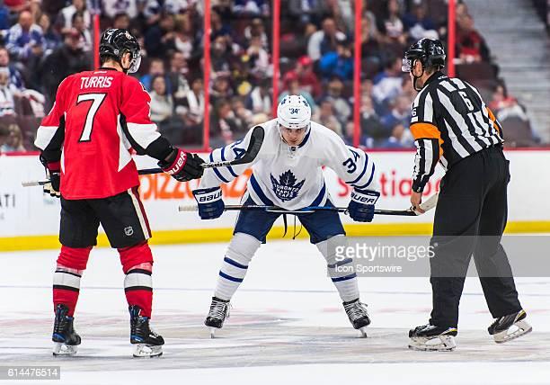Toronto Maple Leafs Center Auston Matthews prepares for a faceoff against Ottawa Senators Center Kyle Turris during the NHL game between the Ottawa...