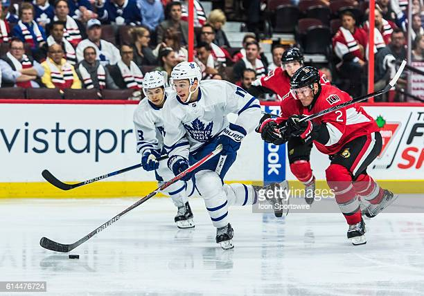 Toronto Maple Leafs Left Wing Zach Hyman stickhandles the puck against Ottawa Senators Defenceman Dion Phaneuf during the NHL game between the Ottawa...