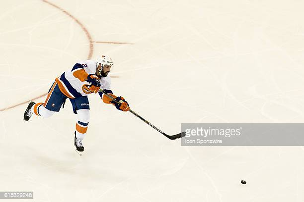 New York Islanders Denfenseman Nick Leddy centers the puck during the second period of opening night at Madison Square Garden in a NHL game between...