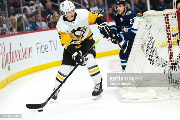 Pittsburgh Penguins defenseman John Marino looks to make a pass during the regular season game between the Winnipeg Jets and the Pittsburgh Penguins...