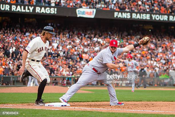 St. Louis Cardinals first baseman Matt Adams reaches to make the catch and tag out San Francisco Giants right fielder Hunter Pence , in the 9th...