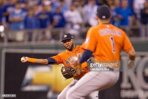 Houston Astros third baseman Luis Valbuena throws around Houston Astros shortstop Carlos Correa to first base during the ALDS series game between the...