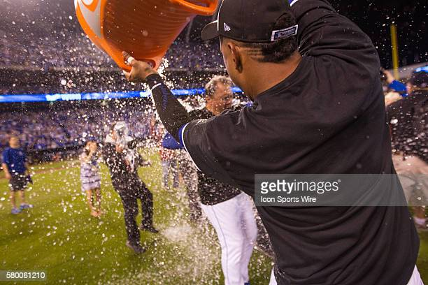 Kansas City Royals catcher Salvador Perez dumps the gatorade bucket on Royals manager Ned Yost after winning the ALDS series game between the Houston...