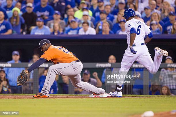 Kansas City Royals center fielder Lorenzo Cain reaches for first base as Houston Astros first baseman Chris Carter makes the out during the ALDS...