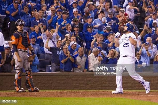 Kansas City Royals designated hitter Kendrys Morales crosses home plate after hitting a 3 run home run during the ALDS series game between the...