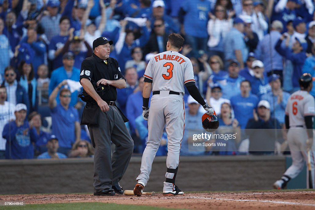 Baltimore Orioles third baseman Ryan Flaherty (3) talks with home plate umpire Ron Kulpa (46) after striking out looking in the 5th inning of Game 4 of the American League Championship Series between the Baltimore Orioles and the Kansas City Royals at Kauffman Stadium in Kansas City, Missouri.
