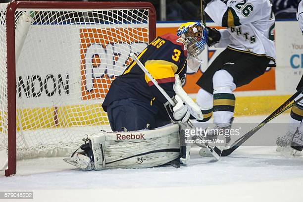 October 15, 2014. Erie Otters goalie Devin Williams makes a save during a game between the London Knights and the Erie Otters played at Budweiser...
