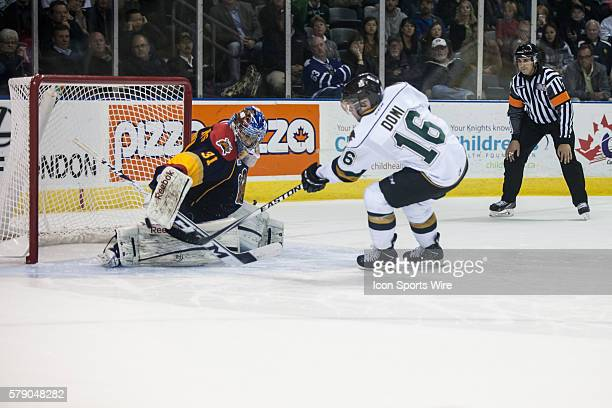 October 15 2014 Max Domi of the London Knights scores the game winning goal against Erie Otters goalie Devin Williams in a shootout during a game...