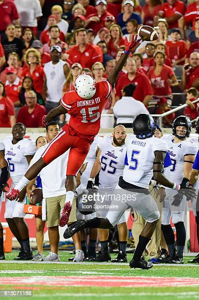 Late second half pass goes off the fingertips of Houston Cougars wide receiver Linell Bonner as Tulsa Golden Hurricane linebacker Tim Quickel defends...
