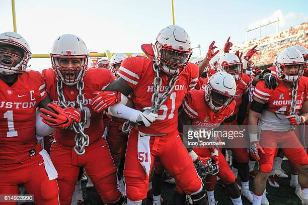 Houston Cougars go through pregame ritual wearing chains in the endzone before the Tulsa Golden Hurricanes at Houston Cougars game at TDECU Stadium...
