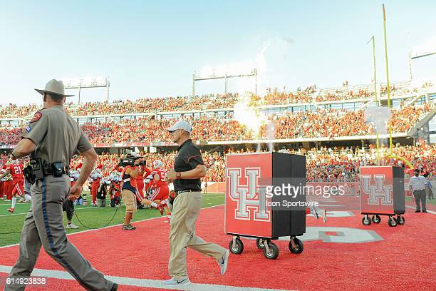 Houston Cougars head coach Tom Herman enters the field before the Tulsa Golden Hurricanes at Houston Cougars game at TDECU Stadium Houston Texas