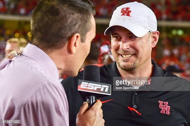Houston Cougars head coach Tom Herman is all smiles during an ESPN postgame interview following the Tulsa Golden Hurricanes at Houston Cougars game...