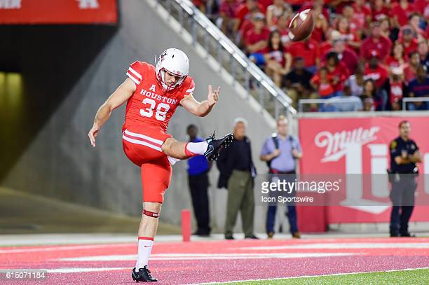 Houston Cougars punter Dane Roy punts from his own endzone late in the second half during the Tulsa Golden Hurricanes at Houston Cougars game at...