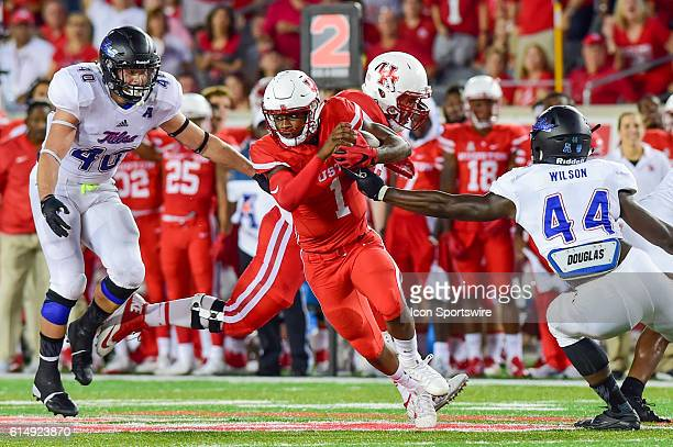 Houston Cougars quarterback Greg Ward Jr. Finds running room as he cuts back to the middle of the field during the Tulsa Golden Hurricanes at Houston...