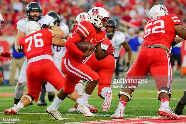 Houston Cougars quarterback Greg Ward Jr follows his blockers as he cuts to the outside during the Tulsa Golden Hurricanes at Houston Cougars game at...