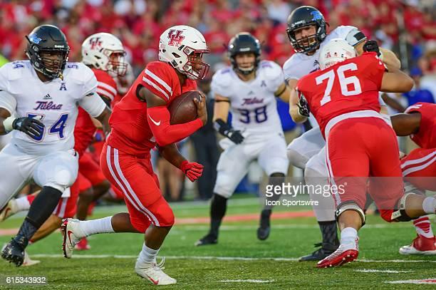 Houston Cougars quarterback Greg Ward Jr gets a good block by Houston Cougars offensive linesman Kameron Eloph during the Tulsa Golden Hurricanes at...