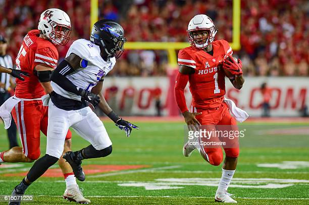 Houston Cougars quarterback Greg Ward Jr. Looks for running room around the left end during the Tulsa Golden Hurricanes at Houston Cougars game at...