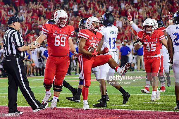 Houston Cougars running back Dillon Birden celebrates a late second half touchdown during the Tulsa Golden Hurricanes at Houston Cougars game at...