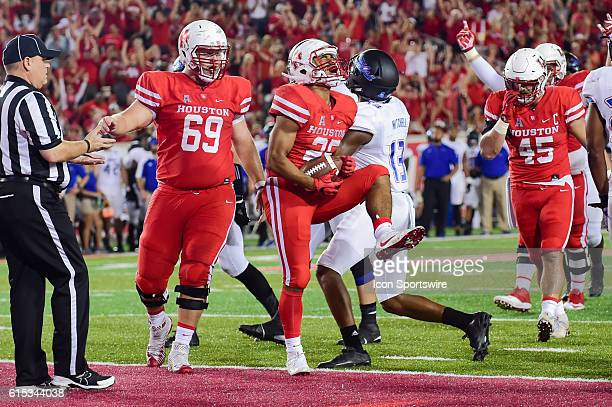 Houston Cougars running back Dillon Birden celebrates his rushing touchdown during the Tulsa Golden Hurricanes at Houston Cougars game at TDECU...