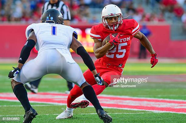 Houston Cougars running back Dillon Birden cuts back to the inside as Tulsa Golden Hurricane cornerback Keanu Hill defends during the Tulsa Golden...