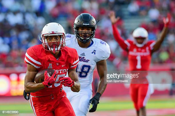 Houston Cougars running back Dillon Birden finds daylight enroute to the endzone as Houston Cougars quarterback Greg Ward Jr signals touchdown during...