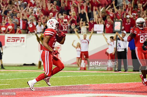 Houston Cougars running back Dillon Birden scores a late second half touchdown to the Cougar crowd's delight during the Tulsa Golden Hurricanes at...