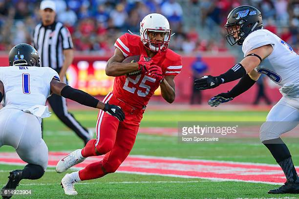 Houston Cougars running back Dillon Birden splits two defenders enroute to a first half rushing touchdown during the Tulsa Golden Hurricanes at...
