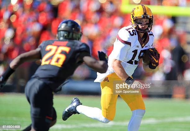Minnesota Golden Gophers quarterback Conor Rhoda looks towards Maryland Terrapins defensive back Darnell Savage Jr during a Big 10 football game at...