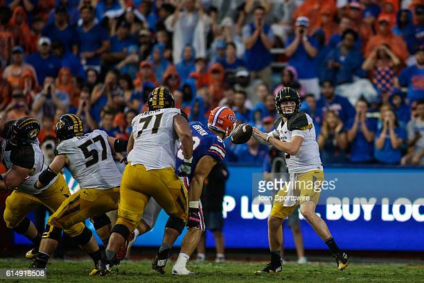 Missouri Tigers quarterback Drew Lock looks for a receiver during the NCAA football game between the Florida Gators and the Missouri Tigers at Ben...