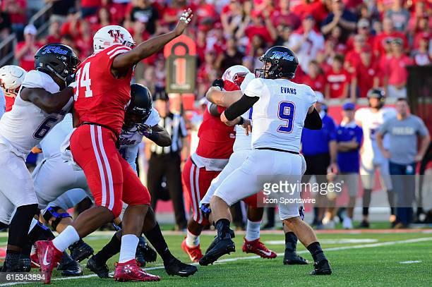 Tulsa Golden Hurricane quarterback Dane Evans feels the pressure of Houston Cougars defensive end Cameron Malveaux during the Tulsa Golden Hurricanes...