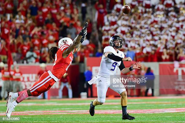 Tulsa Golden Hurricane quarterback Dane Evans gets a pass away as he feels the pressure from Houston Cougars linebacker D'Juan Hines during the Tulsa...