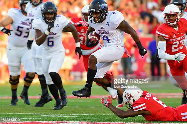 Tulsa Golden Hurricane running back D'Angelo Brewer breaks a tackle attempt by Houston Cougars cornerback Howard Wilson during the Tulsa Golden...
