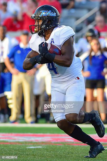 Tulsa Golden Hurricane running back D'Angelo Brewer looks for running room during the Tulsa Golden Hurricanes at Houston Cougars game at TDECU...