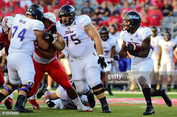 Tulsa Golden Hurricane running back D'Angelo Brewer cuts behind a line of blockers during the Tulsa Golden Hurricanes at Houston Cougars game at...